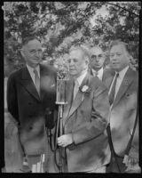 John Steven McGroarty at a microphone with Albert I Stewart, Robert M. Clark and Bernard Brenner at a Brookside Park picnic, Pasadena, 1935