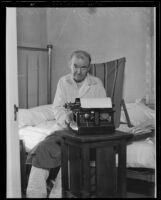 Author John Wiley seated on his bed as he types, 1935