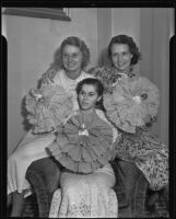 Frances Lord, Vera Johnson and Barbara Durley holding decorations for the International Women's Club breakfast, Los ANgeles