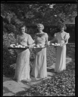 Members of the Assistance Guild carry trays of food and drink at a party hosted by the organization, Los Angeles, 1935