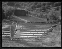 Two women standing next to bleechers at Inglewood Bowl, Centinela Park, Inglewood, 1935