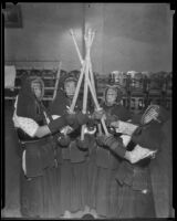 Four youths engaged in Kendo at the 2nd annual Nisei Festival (Nisei Week), Los Angeles, 1935