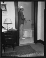 Detective Sergeant Sibley standing near the bathtub where Gladys G. Fair's body was found, Long Beach, 1935