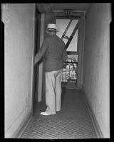 Detective Sergeant Sibley standing at the door leading to Gladys G. Fair's apartment, Long Beach, 1935