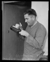Detective Sergeant W. L. Woodruff dusting for fingerprints at the Gladys G. Fair crime scene, Long Beach, 1935