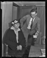 Captain Owen Murphy with Mrs. Florence Boykin Dowling, accused of murdering Gladys G. Fair, Long Beach, 1935