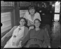 Deportees Ana Maria Gonzales, Soledad Zaragoza and Dorothy Barber in a railroad car, Los Angeles, 1935