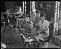 Irving Wells, Kenneth Atherton, and Roland Asher woodworking at an exhibit of arts and crafts and hobbies, Los Angeles, 1935