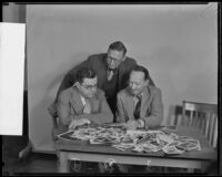 Robert Kenny, Fred Dapprich, and C. J. Ver Halen, judging the Los Angeles Times Amateur Snapshot Contest, Los Angeles, 1935