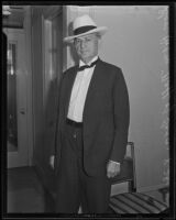 Former Texas Governor Pat M. Neff photographed in a hotel room, (San Diego?), 1935