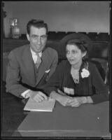 Attorney Theodore Rosenthal and his new bride Evelyn Rosenthal in a courtroom, Los Angeles, 1935