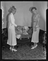 Henrietta Sumner and Beverly Dodge pack suitcase, Los Angeles, 1935
