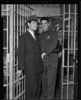 Henry Guttman, convicted on theft charges, being searched by Deputy Jailer Herbert Young, Los Angeles, 1935