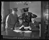 Lt. T.L. Sharp, Captain William E. Nevis, Major G.A. Benedict, and Lt. Col. H.H. Morehead assemble, Los Angeles, 1935