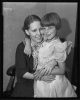 Gladys Carter and daughter Virginia embrace, Newhall, 1935