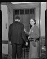 Deputy Marshal Betty Kay Smith demonstrates handling a prisoner, Los Angeles, 1935