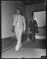 Attorney William Mosely Jones walking with briefcase, Los Angeles, 1935