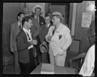 John Moore speaking with Lou Daro after the death of William Focher, Los Angeles, 1935