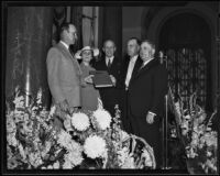 Fire Chief Ralph J. Scott receives a hand-illuminated book at a surprise party in his honor, Los Angeles, 1935
