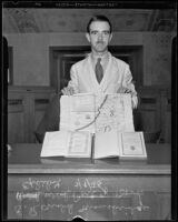 Ronald Mansbridge shows some rare books on display at the Los Angeles Public Library, Los Angeles, 1935
