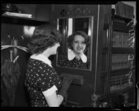 Estelle Taylor, actress, gazing into a mirror, Los Angeles, 1935