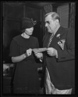 Widow Ivy Focher receives a check from Lou Daro, Los Angeles, 1935