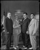 Police Chief Frank Davis, Mayor Frank Shaw, and Sheriff Gene Biscailuz welcome Mexican Governor Jose Mijares Palencia, Los Angeles, 1935