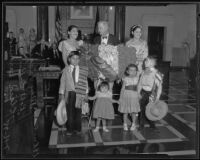 Councilman Robert Burns greets citizens Lucy Vasquez, Clara Bermudez, and some children, Los Angeles, 1935