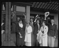 W. R. Dresslen, Mrs. W. R. Dresslen, Luther L. Mack, Mrs. Luther Mack, John E. Bauer, Mrs. John Bauer, and Frank Weller from the Lions Club raise their hats as they leave for Mexico, Los Angeles, 1935