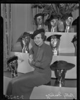 Betty Darling poses with hat display, Los Angeles, 1935