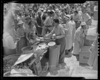 Sheriff Gene Biscailuz serving food at the Sheriff Barbecue, Los Angeles, 1935