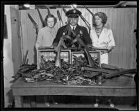 Police Mona Rehling, James E. Davis, and Mabel D. Stevens show weapons ready for disarmament, Los Angeles, 1935