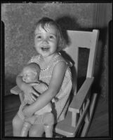 Barbara Lee Taber, runaway child, smiling with her doll, Los Angeles, 1935