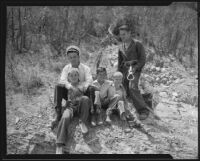 Battalion Chief Ward and Fireman Booth with the rescued Clarence Ward, Robert Jeanette and Robert Ellis, Arroyo Seco, 1935