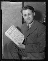 Composer Franz Steininger holding sheet music for the piano, Los Angeles, 1935