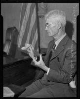 Milton Shepardson peddles rocks as medicine, Los Angeles, 1935