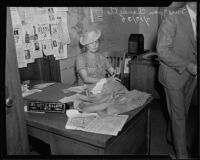 Joan Claudette is apprehended on charges of mail fraud, Los Angeles, 1935