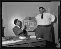 "Judge Joseph Marchetti and Henry ""Happy Hi"" Rohwer holding the stop sign to be used for Henry's punishment for a traffic violation, Los Angeles, 1935"