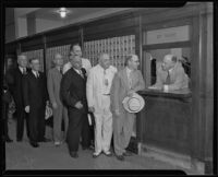 Postmaster Henry B. R. Briggs waits on businessmen J. B. Van Nuys, James Rathwell Page, Ben R. Meyer, J. W. Elliott, and Stiles O. Clements, Los Angeles, 1935