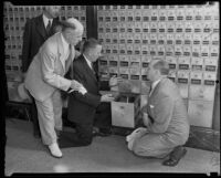 Postmaster H. B. R. Briggs, J. F. Bourne, Walter Brownsweiger, and an unidentified man by the P.O. boxes, Los Angeles, 1935