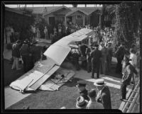 Plane crashes in front yard on Van Ness and Slauson, Los Angeles, 1935