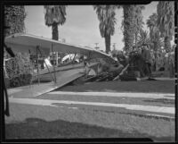Plane crashes in front yard at Van Ness and Slauson, Los Angeles, 1935