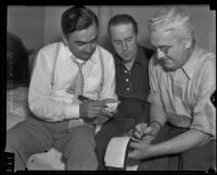 Dr. Ralph Wagner discussing extortion threats with Sheriff Eugene Biscailuz and Joseph E. P. Dunn, Santa Clarita, 1935