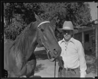 Dr. Ralph Wagner, extortion victim, with his horse, Santa Clarita, 1935