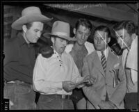 Dr. Ralph Wagner, Hank Hankinson, Ernie Wagner, and unidentified men viewing extortion note, Santa Clarita, 1935