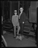 Heber J. Grant and J. Reuben Clark, Mormons, at train station, 1935