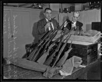 Deputy Lieutenant Harry A. Toland and Sargent Elmer Larson with guns used in Monte Carlo robbery, 1935