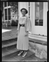 Miss Nathalie Whiting stands outside on steps, Beverly Hills, 1935