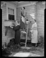Mrs. Delano, Mrs. Hayes, and Mrs. Drake of West Adams Women's Club paint new clubhouse, Los Angeles, 1935