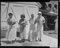 Mrs. H. M. White, Mrs. H. E. Bayhi, Mrs. Genevieve Paonessa, and Mrs. Donald Jennings in sunbonnets at garden party, Los Angeles, 1935